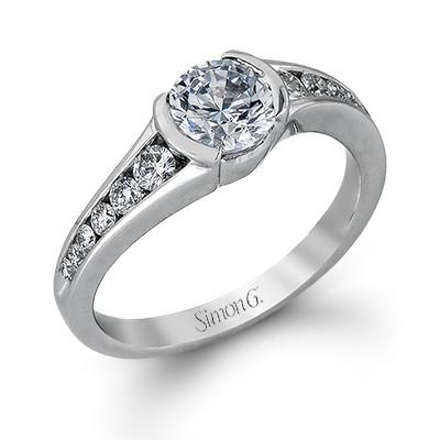 Simon G MR2294ER 18 Karat White Gold Engagement Ring with Twelve Full Cut Round Diamonds In a Tapered Channel Shank.  The Diamon by Simon G