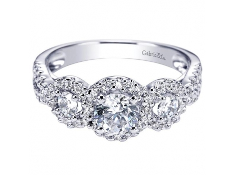 Gabriel&Co 14KT White Gold Contemporary Halo Engagement Ring with Side Diamonds Totaling .78CT TDW